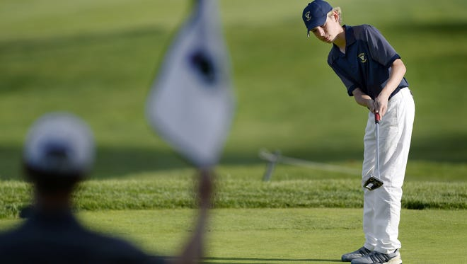 Victor's Aiden Spampinato watches his putt on the 15th green during Super Sectionals at The Country Club of Rochester, Monday, May 21, 2018. Spampinato finished with a two-round score of 156.