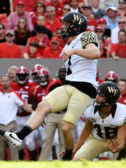 Mike Weaver kicks one of his three field goals in a 2016 loss to North Carolina State.