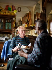 Niels Billund, a registered nurse and case manager for Fairview Home Care and Hospice, laughs with patient Roy Cato during a visit to Cato's home in Minneapolis, Minn.