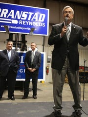 Iowa Gov. Terry Branstad was joined by New Jersey Gov. Chris Christie, at left in background, at a campaign stop at Gee Asphalt in Cedar Rapids last Friday.