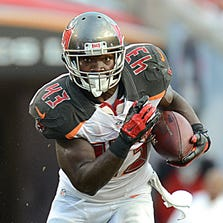 Tampa Bay Buccaneers running back Bobby Rainey runs  the the ball in the second half against the St. Louis Rams  at Raymond James Stadium.