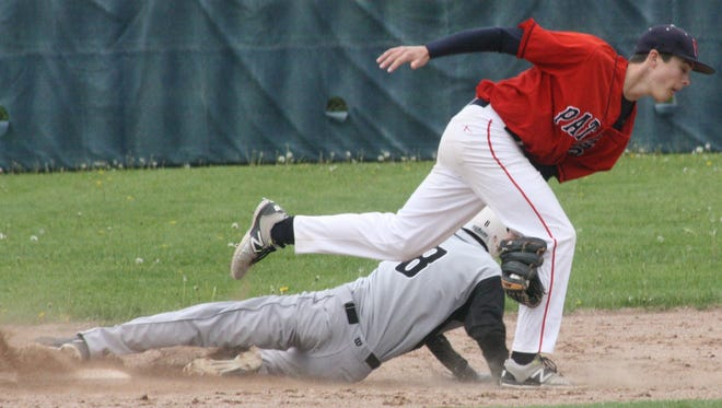 Franklin shortstop Kolby Dewhirst tagged out Andrew Hejka on an attempted steal of second Wednesday.