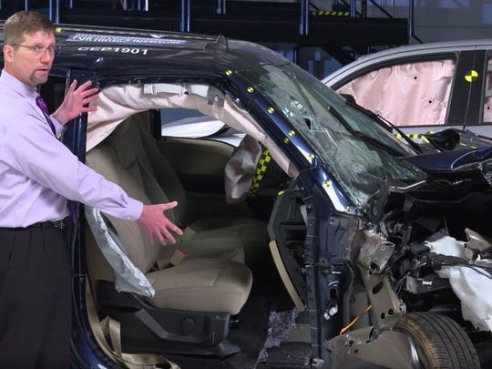 David Zuby, chief research officer for the IIHS, shows off a crash-tested Ford F-150. The truck earned the IIHS Top Safety Pick designation every year since 2015 until 2019.