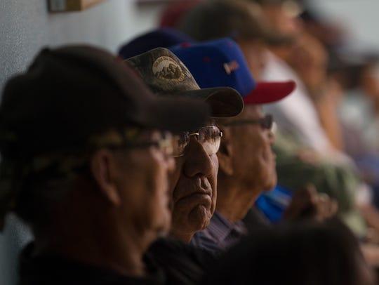Community members attend a special meeting regarding