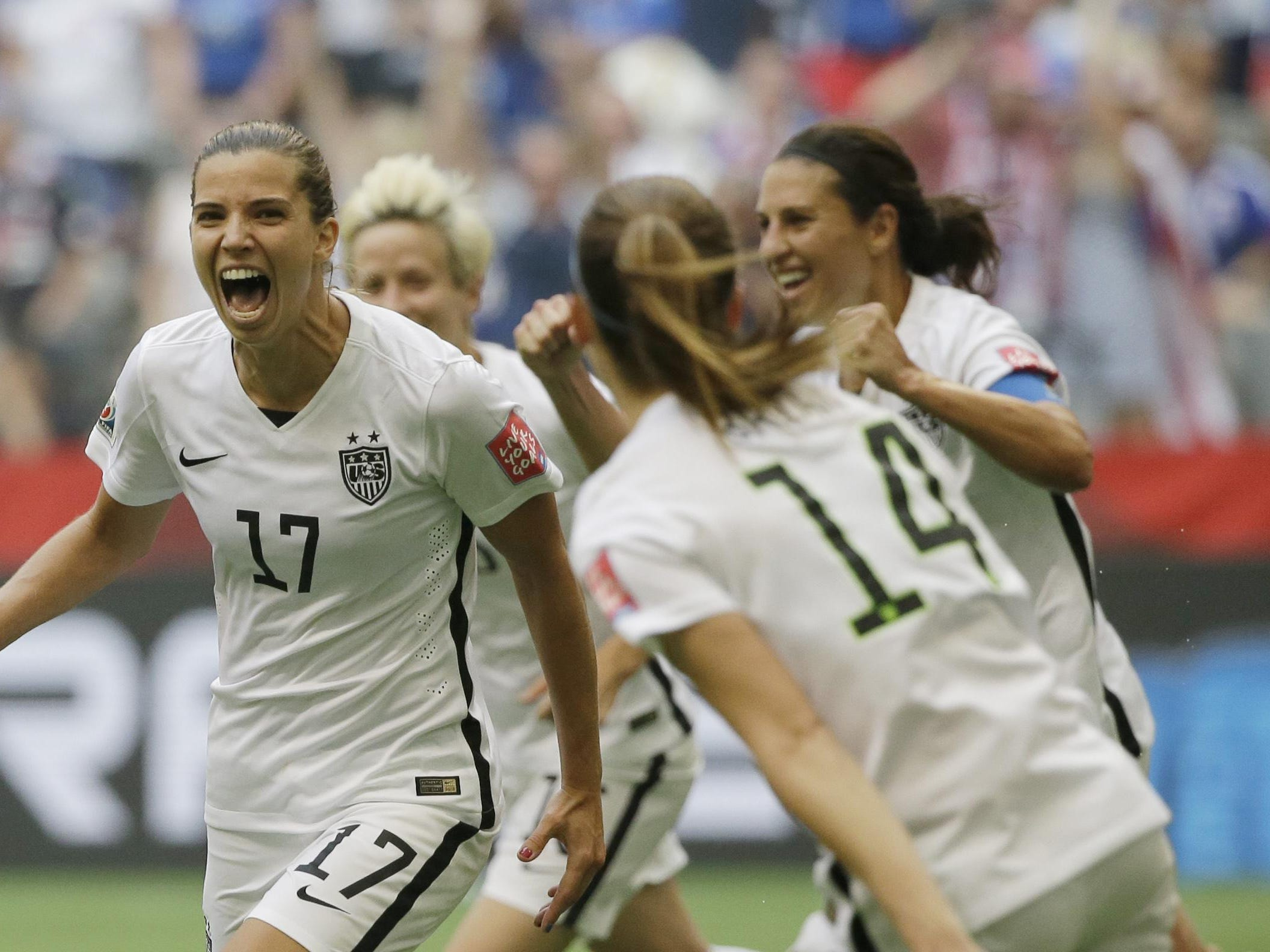 United States' Tobin Heath, left, celebrates after she scored a goal against Japan during the second half of the FIFA Women's World Cup soccer championship in Vancouver, British Columbia, Canada, Sunday, July 5, 2015.