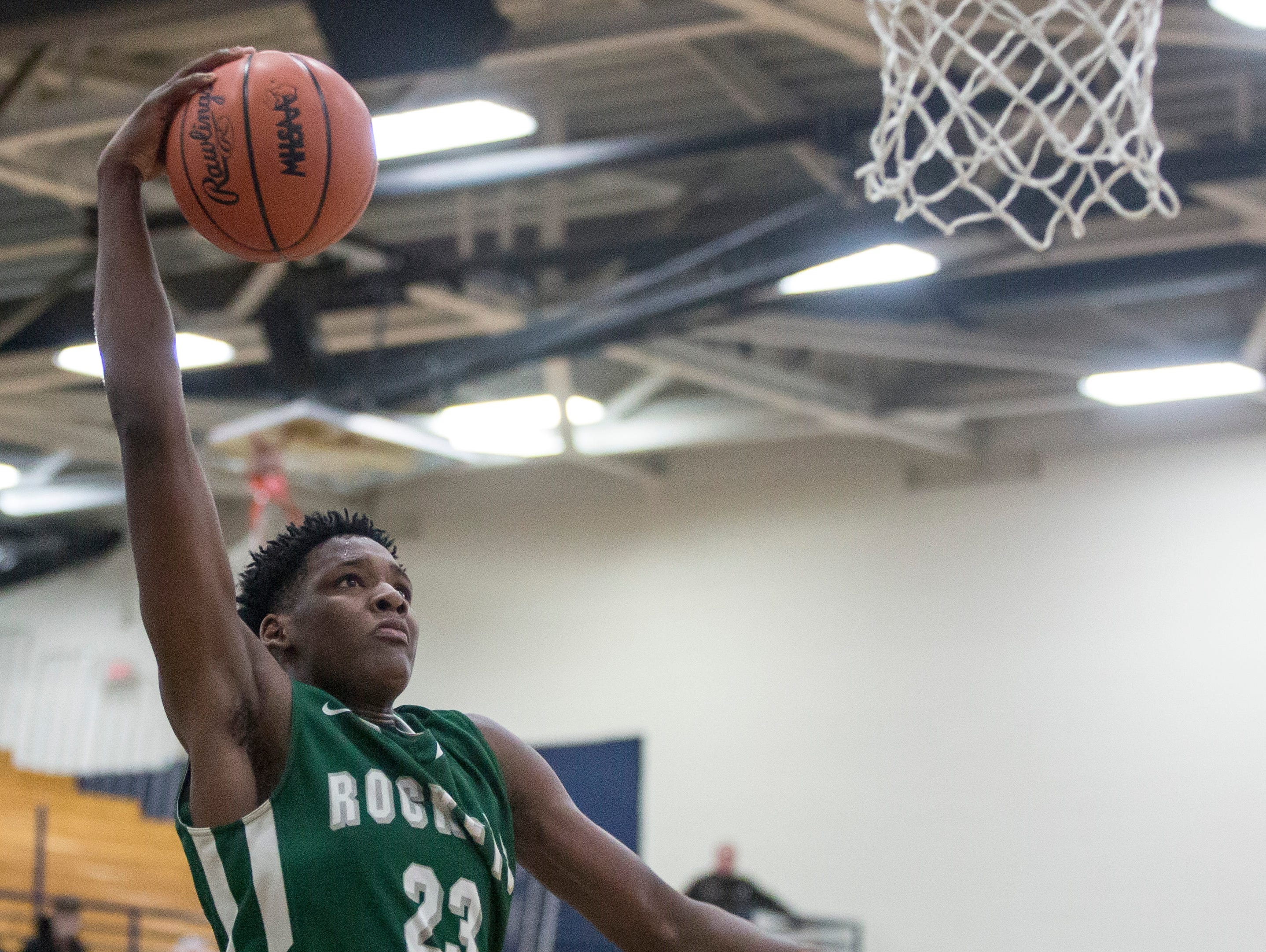 New Haven's Romeo Weems dunks the ball during a regional final basketball game Wednesday, March 15, 2017 at North Branch High School. New Haven defeated Pontiac Notre Dame Prep 71-44.