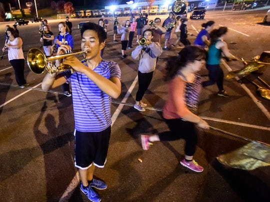 Warren Chan, of Vestal, practices his moves during band practice at the school's auditorium on Tuesday.