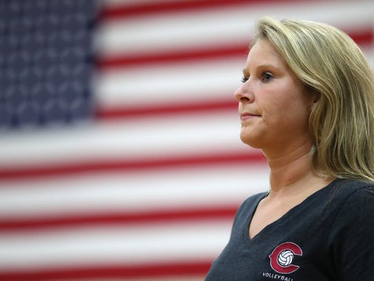 Chiles coach Kaitlin DiLuzio leads her team from the