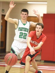 Norfork's Saul Maple passes while defended by Yellville-Summit's