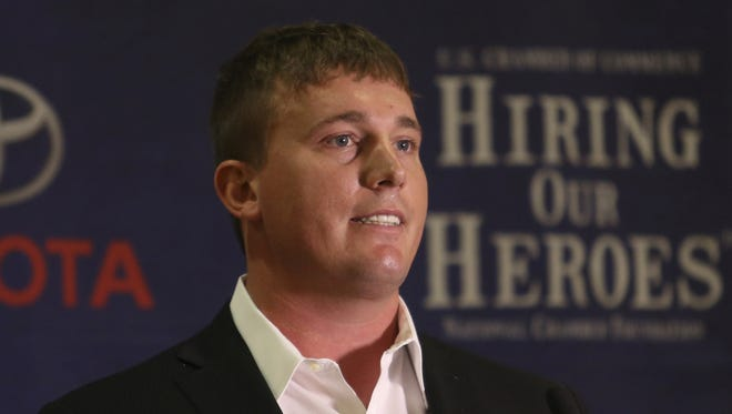 Medal of Honor recipient Dakota Meyer talks to the crowd at a Veterans Job Fair in Louisville, Ky., on Friday, Feb. 21, 2013. Meyer invites Islamic State  to visit him so he can kill them. His comments are in response to the FBI asking service members to scrub their social media accounts.