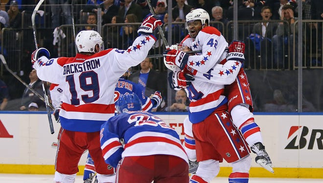 Washington Capitals right wing Joel Ward (42) celebrates after scoring the game-winning goal with teammates against the New York Rangers during the third period in game one of the second round of the 2015 Stanley Cup Playoffs at Madison Square Garden.