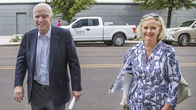 Sen. John McCain and his wife, Cindy, enter the Republic Media building in downtown Phoenix on Aug. 3, 2017.