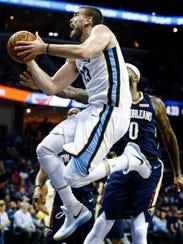 Memphis Grizzlies center Marc Gsaol drives the basket