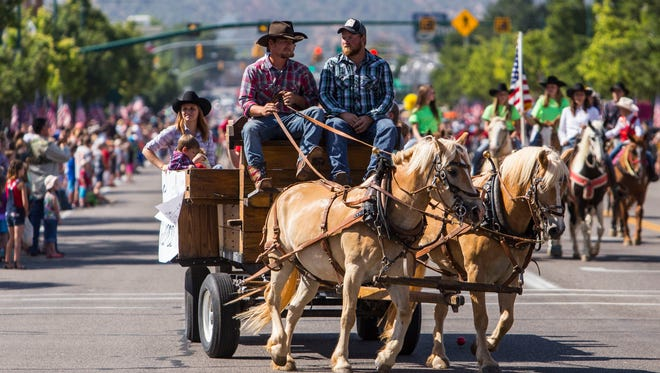 Cedar City residents ride down Main Street during Monday's Pioneer Day parade, July 25, 2016.