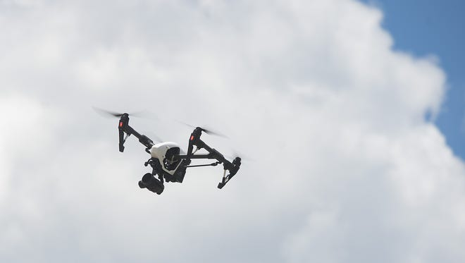 A drone flies above the Poudre Fire Authority training facility during a demonstration on Thursday, June 22, 2017.