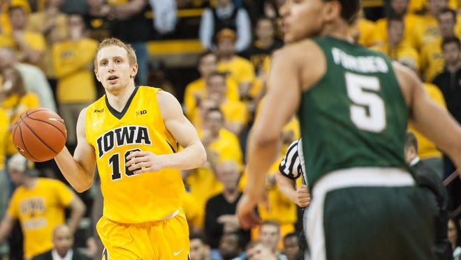 Dec 29, 2015; Iowa City, IA, USA; Iowa Hawkeyes guard Mike Gesell (10) dribbles the ball during the second half against the Michigan State Spartans at Carver-Hawkeye Arena. The Hawkeyes won 83-70. Mandatory Credit: Jeffrey Becker-USA TODAY Sports