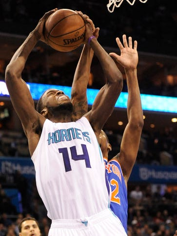 Michael Kidd-Gilchrist (14) scored 10 points for the
