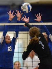 Sioux Falls Christian's Grace Perrenoud spikes the