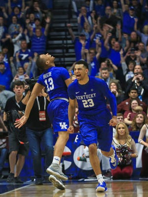 Kentucky's Isaiah Briscoe, left, and Jamal Murray celebrate as the Wildcats beat Texas A&M 82-77 in overtime in the SEC Tournament Championship game Sunday at Bridgestone Arena.