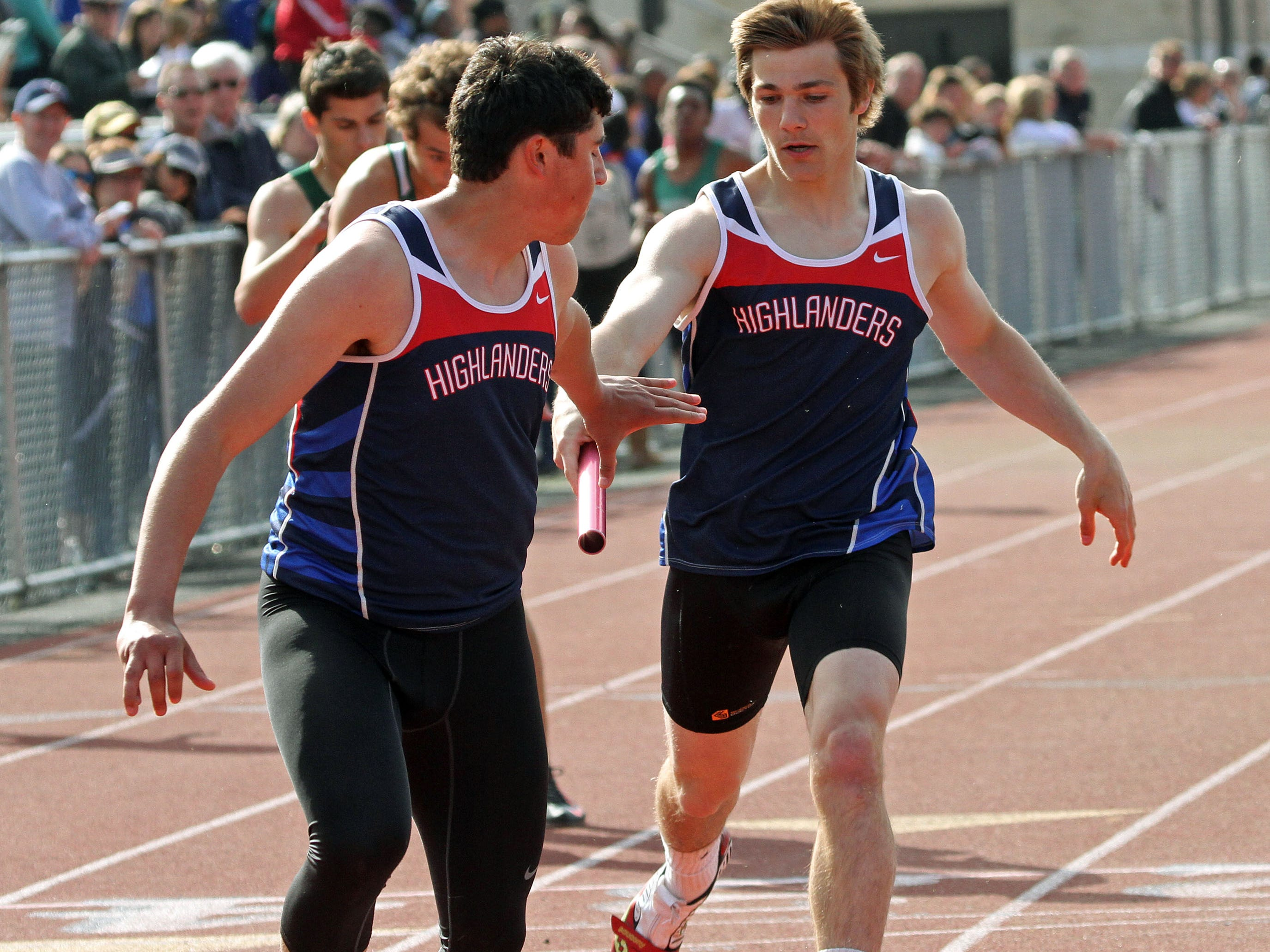 Governor Livingston's Nick DeLuca, right, hands off the baton to James Ruggiero during the 4x100. This is action of the Union County Track and Field Relays.