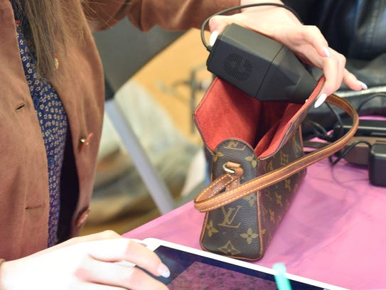 Gucci and Louis Vuitton handbags are examined for authenticity