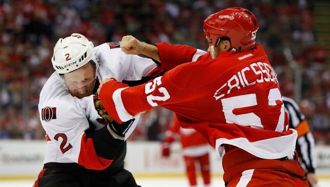 Jonathan Ericsson fights Ottawa Senators defenseman Dion Phaneuf on Oct. 17.