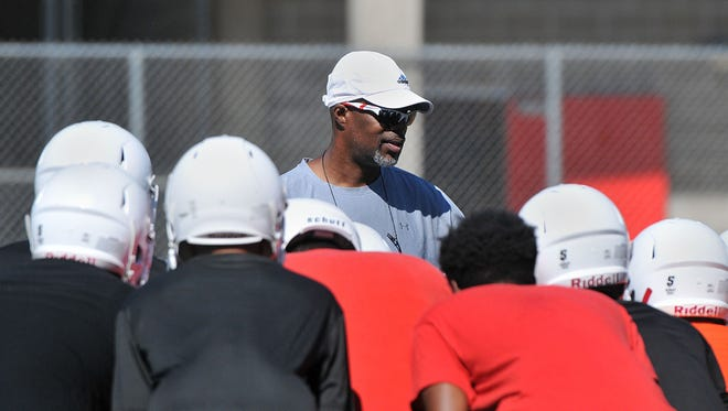 Marcelle Carruthers, shown giving instructions to his players last August, has stepped down as Everett's football coach.