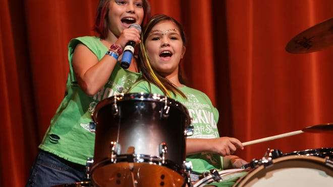 Swagalicious band members Skyler Landis (left) and Susanna Swinger perform July 27, 2014, during the Girls Rock! Indianapolis showcase, at Warren Performing Arts Center.