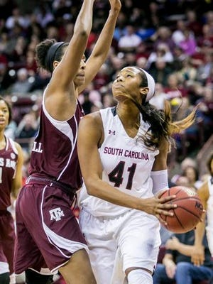 Jan 26, 2015; Columbia, SC, USA; South Carolina Gamecocks center Alaina Coates (41) prepares to shoot the ball as Texas A&M Aggies center Rachel Mitchell (23) defends in the second half at Colonial Life Arena. Mandatory Credit: Jeff Blake-USA TODAY Sports