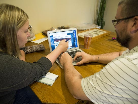 Courtney and Andrew Nagengast pay bills electronically