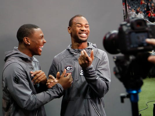 Georgia's Terry Godwin, right and Mecole Hardman pose for photos during media day, Saturday, Jan. 6, 2018, in Atlanta. Georgia and Alabama will be playing for the NCAA football national championship on Monday, Jan. 8. (AP Photo/David Goldman)