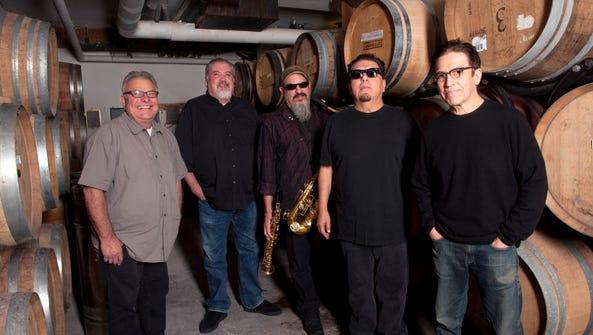Los Lobos, from left, are Conrad Lozano, David Hidalgo, Steve Berlin, Cesar Rosas and Louie Perez.