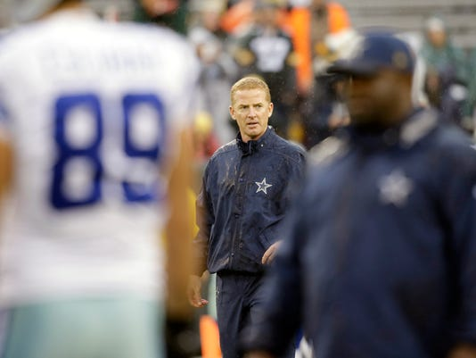 FILE - In this Dec. 13, 2015, file photo, Dallas Cowboys head coach Jason Garrett is shown before an NFL football game against the Green Bay Packers, in Green Bay, Wis. Garrett is assured of his first losing season as the coach in Dallas. (AP Photo/Jeffrey Phelps, File)