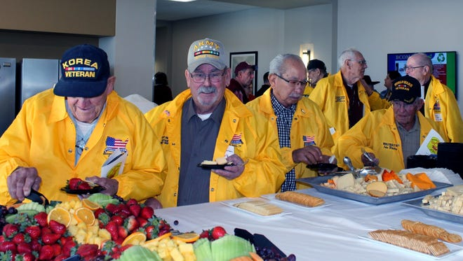 Veterans enjoy snacks during a viewing of a documentary about their Honor Flight trip to Washington, D.C.