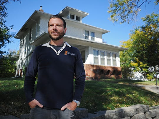 John Koch, of John Koch Construction, poses for a portrait in front of a house owned by Avera McKennan Wednesday, Oct. 14, 2015, at the corner of 7th Avenue and 20th Street across from the Avera McKennan Hospital & University Health Center in Sioux Falls. Avera plans to demolish the house, but Koch thinks it could be restored and would benefit the neighborhood.