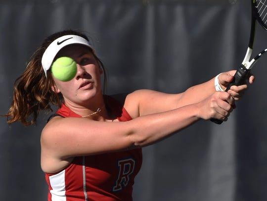 Reno high's Jill Rovetti hits a forehand during a regional