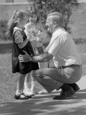 George Dodson greets returning students at Smith Elementary on the first day of school in 1989.