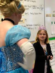 Nine-year-old Hanna Stenzel talks with Cinderella in her third-grade class at Jefferson Elementary School in Manitowoc.