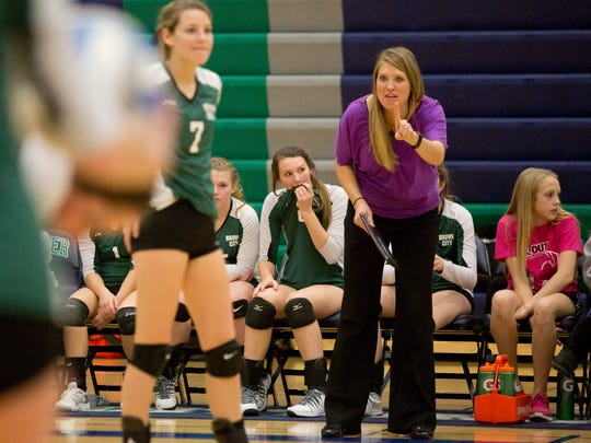 Brown City coach Jenna Welke instructs players from the sidelines during a Class C quarterfinal volleyball game Tuesday, November 17, 2015 at Lapeer High School.