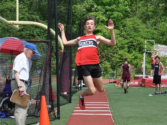 Somers freshman Patrick Eames in flight during boys
