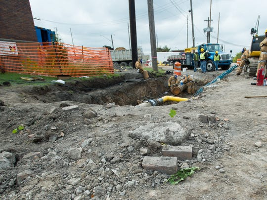 Consumers Energy subcontractor crew closes off an old gas pipe on Ninth Street between Washington and Saginaw avenues in Bay City on Sept. 18.