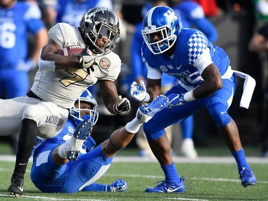 Vanderbilt running back Ralph Webb (7) drives past the Kentucky defense during the first half at Vanderbilt Stadium Saturday, Nov. 11, 2017 in Nashville, Tenn.