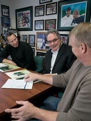 Peter Grandich (center), owner of Trinity Financial