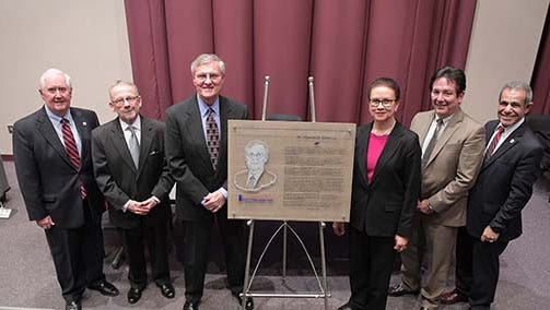 Charles H. Diller, Jr., center left, stands next to a plaque honoring him on Thursday afternoon at the official dedication ceremony of the Charles H. Diller Jr. Center for Entrepreneurial Leadership and Innovation at The Forum in the John L. Grove College of Business at Shippensburg University.  Also in attendance, from left to right, John E Clinton; B Michael Schaul; Dr. Barbara Lyman; Mike Ross; and Dr. John Kooti.