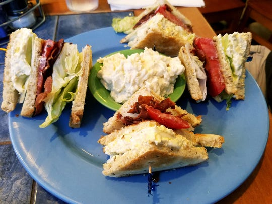 Flamingo Diner's triple decker egg salad and bacon club on rye toast with lettuce and tomato.