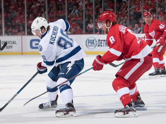 Justin Abdelkader tries to steal the puck from Nikita Kucherov during the first period in Game 3.