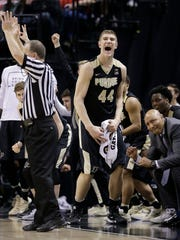 Purdue Boilermakers center Isaac Haas (44) celebrates a Boilermaker three-point play in the second half of their Big Ten Men's Basketball Tournament championship game Sunday, Mar 13, 2016, afternoon at Bankers Life Fieldhouse. The Purdue Boilermakers lost to the Michigan State Spartans 66-62.