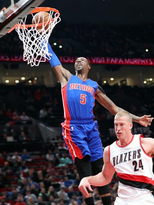 Pistons guard Kentavious Caldwell-Pope (5) dunks over Trail Blazers center Mason Plumlee (24) in the first half Sunday in Portland, Ore.