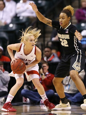 Purdue Boilermakers forward Ae'Rianna Harris (32) guards Indiana Hoosiers guard Tyra Buss (3) during first half action between Indiana and Purdue in the Big Ten women's basketball tournament at Banker's Life Fieldhouse, Indianapolis, Friday afternoon, March 3, 2017.