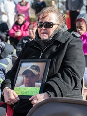 Myrna Coward holds a picture of her son Gary Mapes,